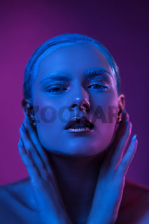 Sexy Woman with Creative Make Up Poses in Blue Lights