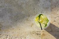 Lemonade glass on stone background
