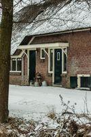 Dutch farmhouse in winter time - entrance doors