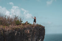 Girl on the beautiful cliff