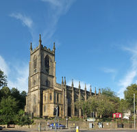 street view of people and traffic passing of christ church in sowerby bridge west yorkshire