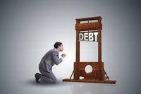 Businessman in heavy debt business concept