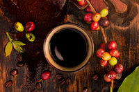 Coffee fruits and roasted coffee beans.