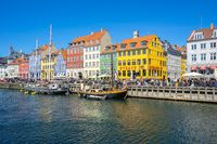 View of Nyhavn pier with color buildings in Copenhagen city, Denamrk