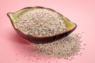 white chia seeds in a leaf bowl