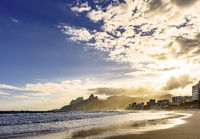 Sunset with clouds at Ipanema beach
