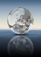 Austria on translucent globe above water