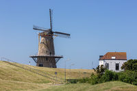 Dutch traditional windmill at dike near Vlissingen