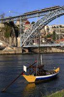 Traditional rabelo boats, Porto city skyline, Douro river and and Dom Luis or Luiz iron bridge. Porto