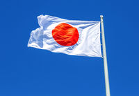 Flag of Japan waving in the wind against the sky