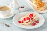 Classic scones with cream and berry jam