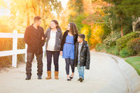 Hispanic Pregnant Family Walking On Path