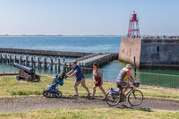 Family with child and cyclist near harbor Dutch village Vlissingen