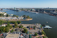 View Dutch harbor Amsterdam with marina, ferry and apartment buildings