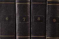 row of vintage books on a bookshelf
