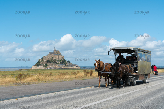 horse and carriage transporting tourists to the famous Mont Saint-Michel in northern France