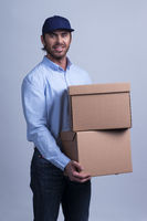 Delivery man carrying box