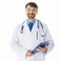 Male Doctor standing with folder