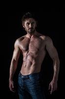 Muscular man cross hands