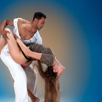 Sensual couple performing an artistic and emotional contemporary dance.