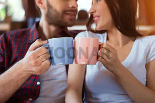 Lovely couple drinking coffee together.