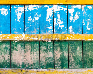 Blue, green and yellow wood wall texture