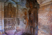 Cave 4 : Carved figure of Tirthankara Parshvanath with his head decorated with a multi-headed cobra representing protection and reverence. Badami, Karnata, India