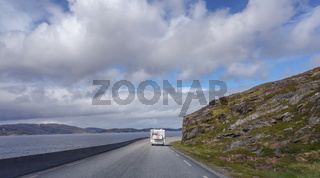 Northern Norway, Camper van on the narrow and windy road leading to Hammerfest on a sunny day