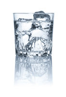 A glass with water and ice cubes