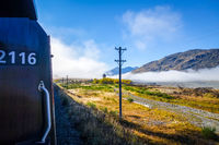 Train in Mountain fields landscape, New Zealand