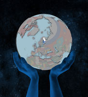Finland on political globe in hands