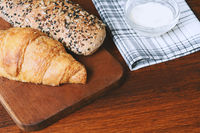 Various types of bread with dip of cream cheese