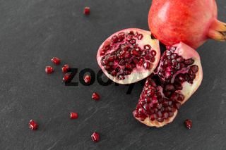 close up of pomegranate on stone table