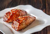 Teriyaki salmon on the white plate