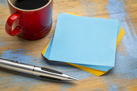 blank reminder note with a cup of coffee