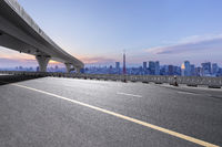 empty asphalt road with city skyline in japan