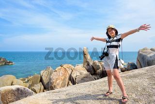 Woman tourist on Hin Ta Hin Yai viewpoint