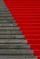 Red carpet over concrete stairs perspective