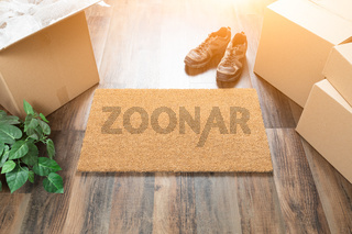 Blank Welcome Mat, Moving Boxes, Shoes and Plant on Hard Wood Floors