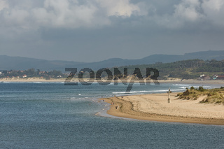 People enjoying a summer day on a beach in Santander, Spain