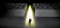 Businessman going straight ahead between two mazes