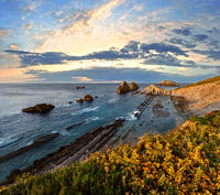 Blossoming Arnia Beach sunset coastline landscape.
