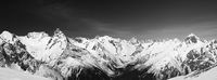 Black and white panoramic view of snow covered mountain peaks
