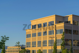 Commercial modern building exterior viewed against blue sky on a sunny day