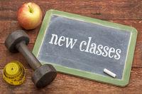 New classes blackboard sign