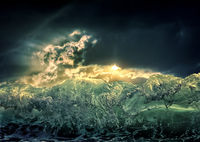 Dramatic dark ocean sea storm view with sun light clouds and waves. Abstract nature background. Climate concept. Extreme weather