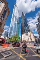 London UK - May 12, 2019 - Business people and tourist walking with skyscrapers in background.