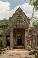 Portico of Preah Khan temple in trees