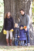 Smiling family in autumn park