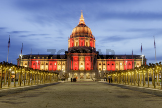 San Francisco City Hall illuminated in Gold and Red for the Chinese New Year.